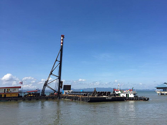 Pile driving at Malaysia ferry terminal wavescreen construction