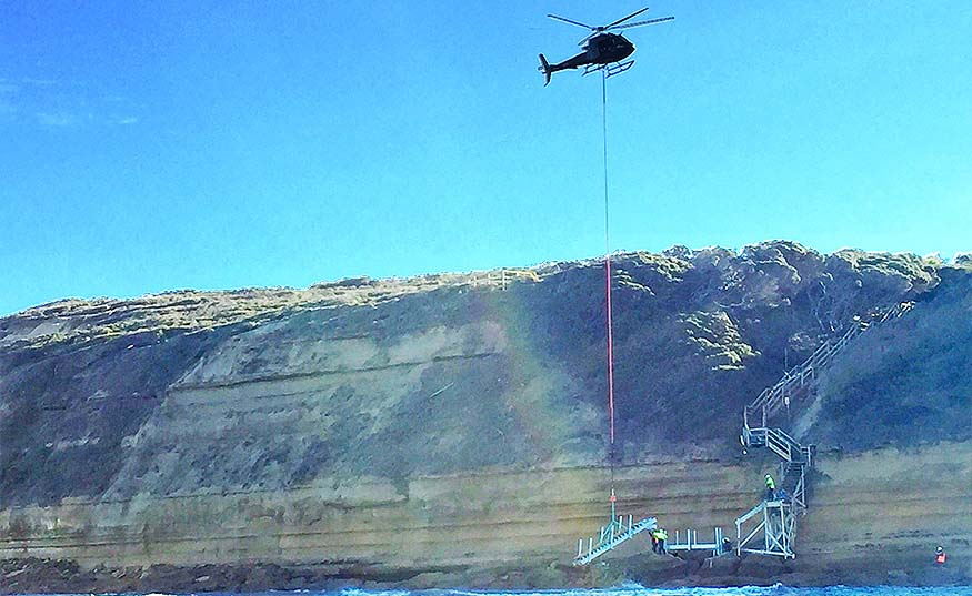 Helicopter lowering beach access steps at Jan Juc beach surf access point