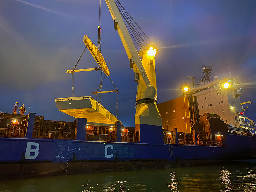 Wave attenuator and ship at night